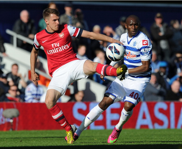 Aaron Ramsey Of Arsenal Challenges Stephane Mbia Of QPR… News Photo - Getty Images - 168029835