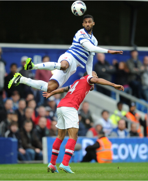 Armand Traore Of QPR Out Jumps Theo Walcott Of Arsenal… News Photo - Getty Images - 168029949