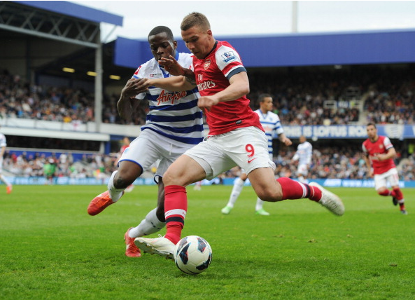 Lukas Podolski Of Arsenal Breaks Past Nedum Onuoha Of QPR… News Photo - Getty Images - 168029951