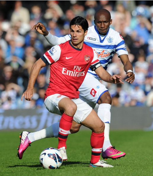 Mikel Arteta Of Arsenal Breaks Past Stephane Mbia Of QPR… News Photo - Getty Images - 168029840