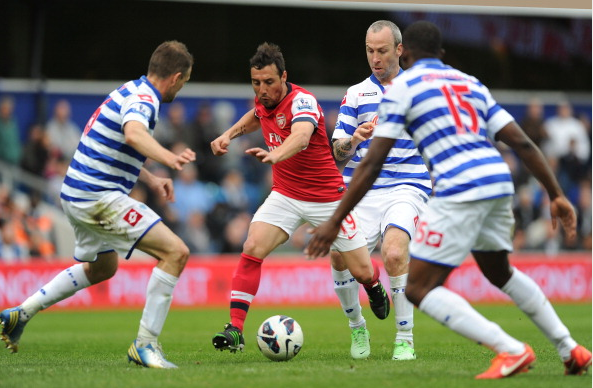 Santi Cazorla Of Arsenal Challenged By Clint Hill Shaun… News Photo - Getty Images - 168029974