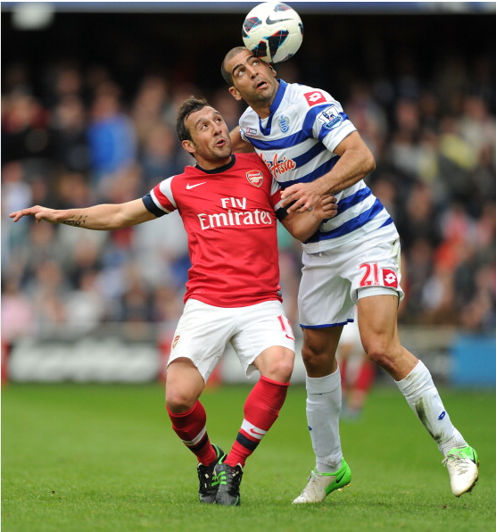 Santi Cazorla Of Arsenal Challenged By Tal Ben Haim Of QPR… News Photo - Getty Images - 168029961