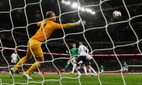 Per Mertesacker watches his header fly beyond Joe Hart