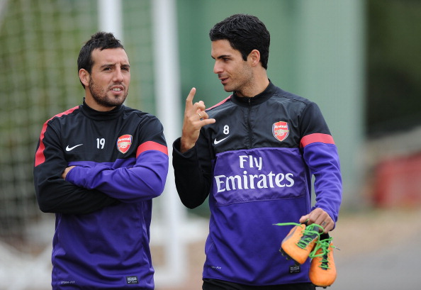 ST ALBANS, ENGLAND - SEPTEMBER 21:  (L-R) Santi Cazorla and Mikel Arteta of Arsenal during a training session at London Colney on September 21, 2012 in St Albans, England.  (Photo by Stuart MacFarlane/Arsenal FC via Getty Images)