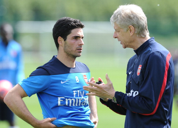 ST ALBANS, ENGLAND - MAY 14:  Arsene Wenger the Arsenal Manager chats to Mikel Arteta of Arsenal during the Arsenal 1st Team Training Session at London Colney on May 14, 2014 in St Albans, England.  (Photo by David Price/Arsenal FC via Getty Images)